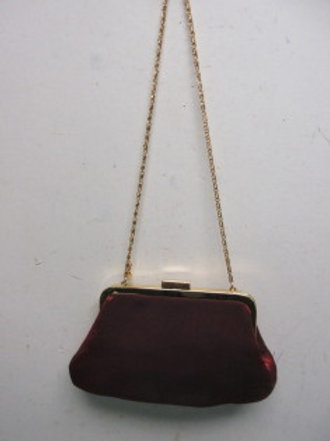 Small red clutch with chain and gem stone accent