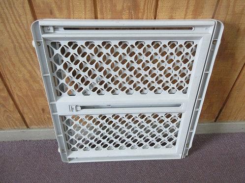 Gray plastic adjustable baby gate