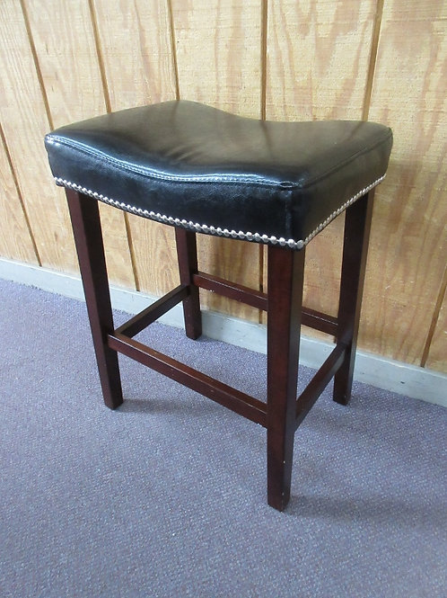 "Cherry saddle bar stool w/black leather seats,silver nail head accents 25"" tall,"