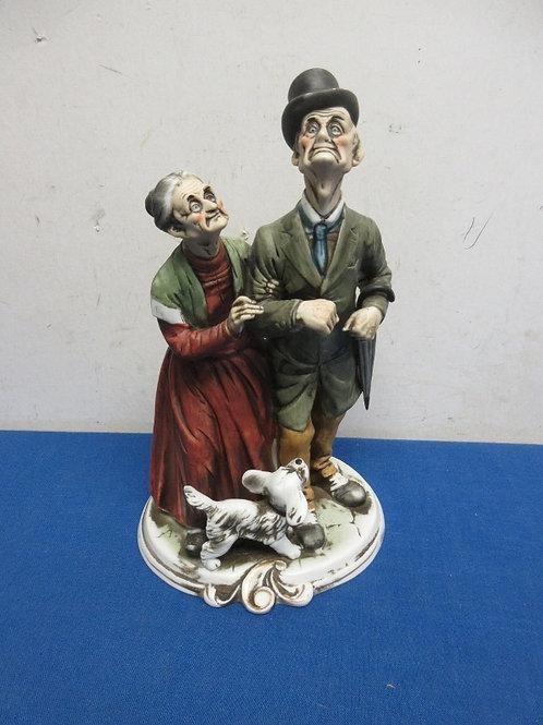 Porcelain bisk old couple and dog statue