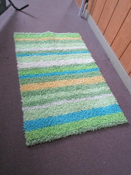 "Stripe shag rug with pastel yellow, blue, green stripes, 30x45"""