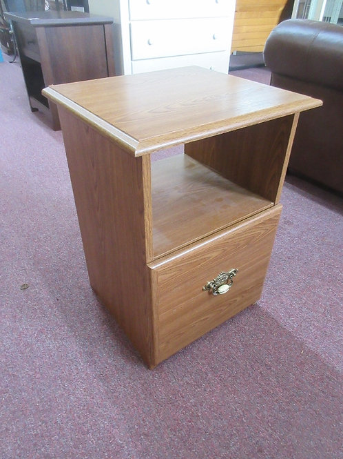 Natural tone end table with 1 file drawer and shelf