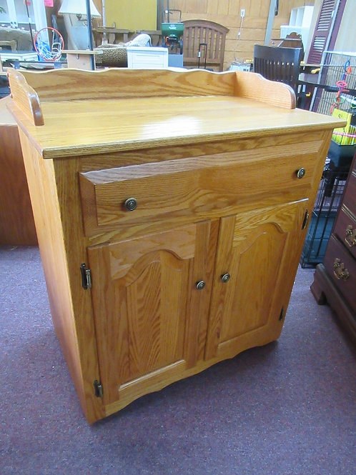 "Oak rolling buffet cart with one drawer and 2 bottom doors, 18x30x32""high"
