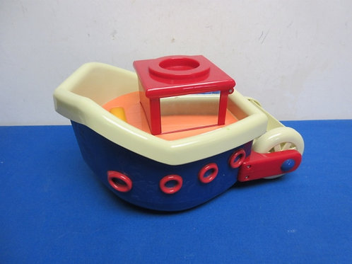 Plastic blue, red and tan toy paddle wheel boat