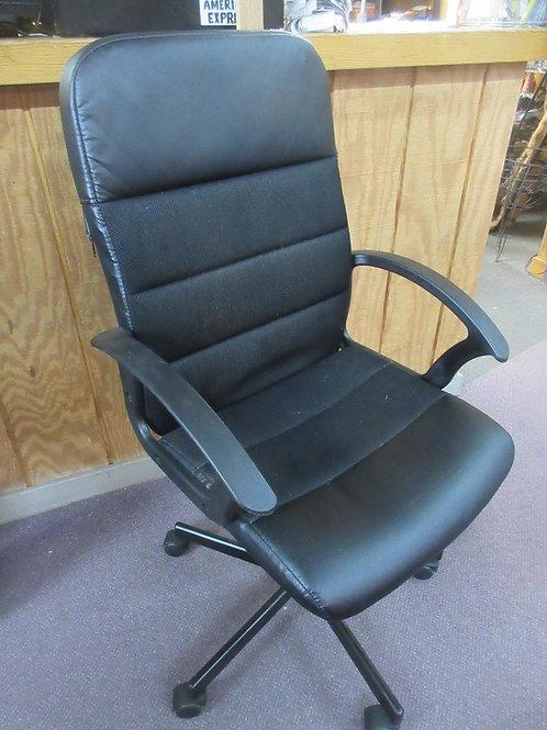 Black high back adjustable office chair on wheels  - Wear