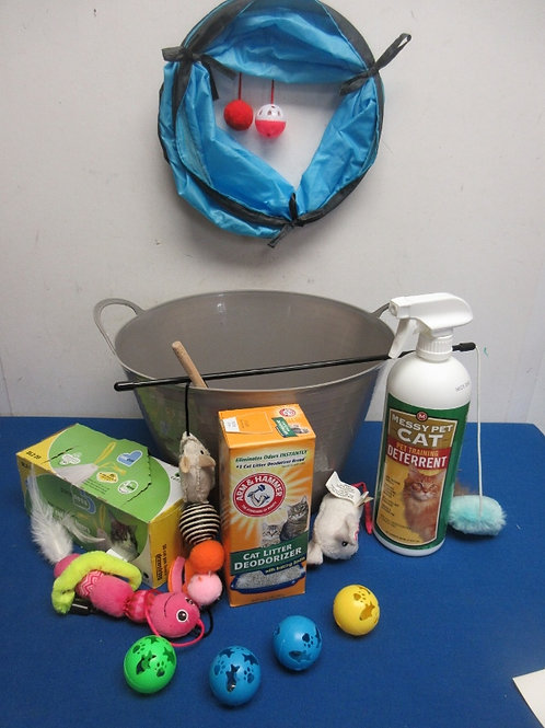 Gray plastic bin with small CAT toys and accessories