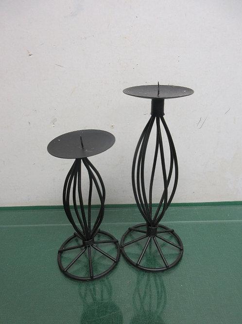 Pair of black metal candle holders