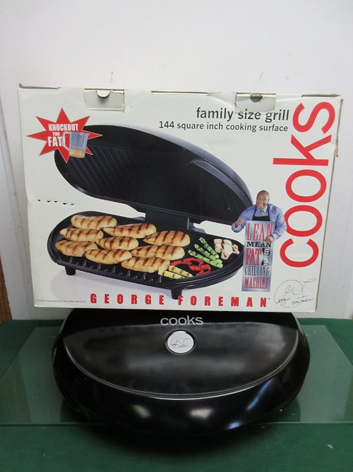 George Foreman cooks family size grill, black in box