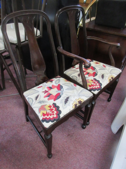 Pair of vintage dark walnut dining chairs with newly upholstered floral seats