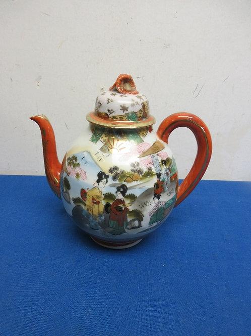 Asian porcelain teapot with lid