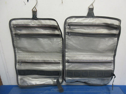 Pair of gray and clear plastic fold up travel organizers