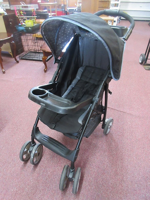 Graco black stroller with sun roof