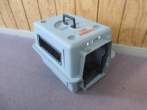 Gray sky kennel w/attached food & water dishes,marked live animal approved for a