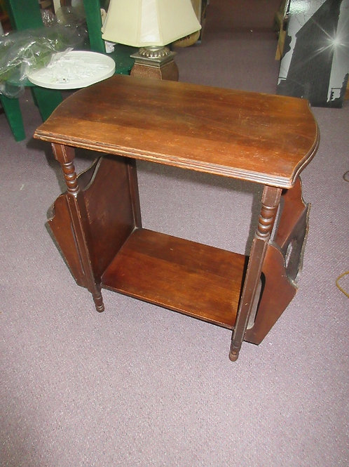 Antique mahogany table with side magazine slots
