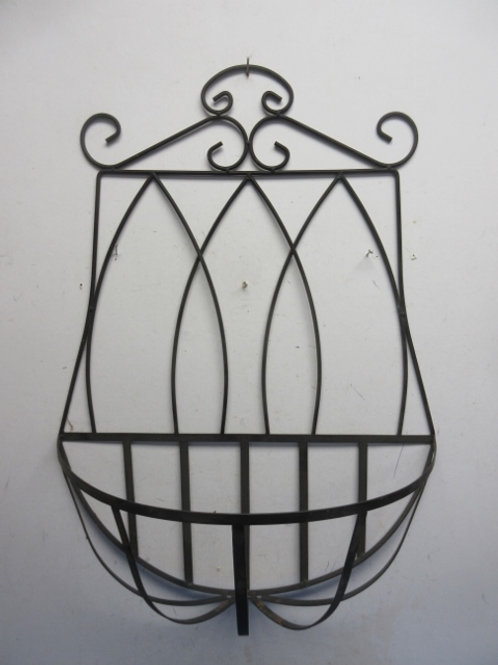 Black metal ornate wall hanging with half circle attached basket