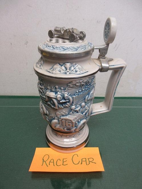 "Avon race car stein, has dimentional race cars on sides, &metal race car lid, 9"""