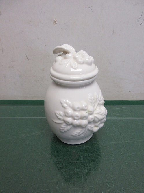 Small white ceramic jar with grape design and dimensional lid