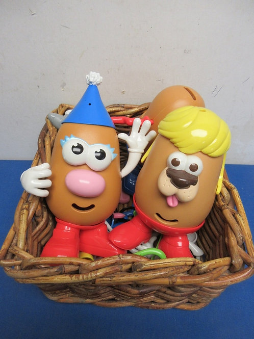 Small basket with 4 Mr. Potato Head figures, and asssorted accessories
