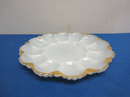 White glass deviled egg dish with gold trim