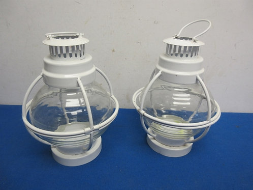 Pair of white metal and glass round candle lanterns
