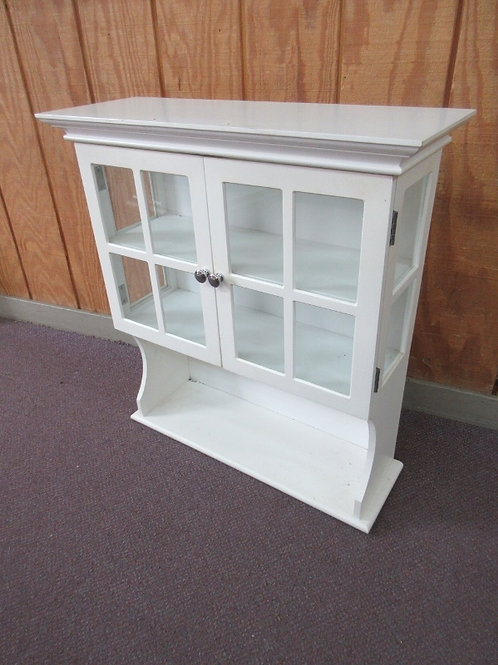 White wood bathroom cabinet with double doors