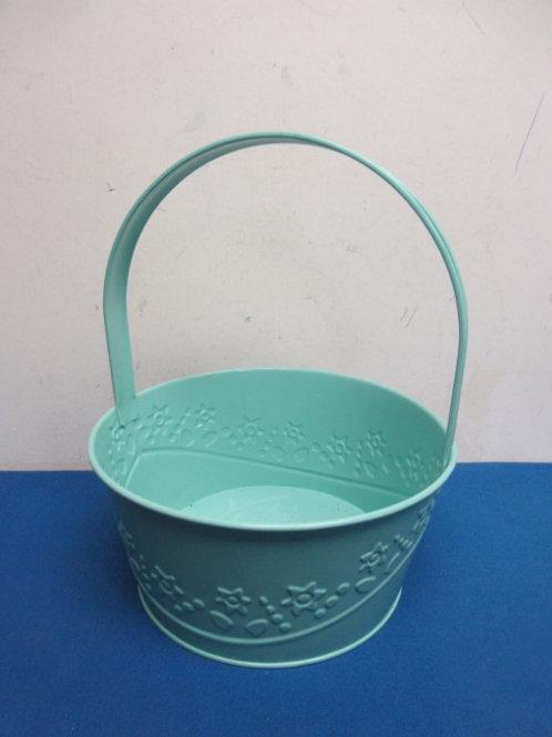 "Green metal basket with handle,9"" dia, 12"" high"