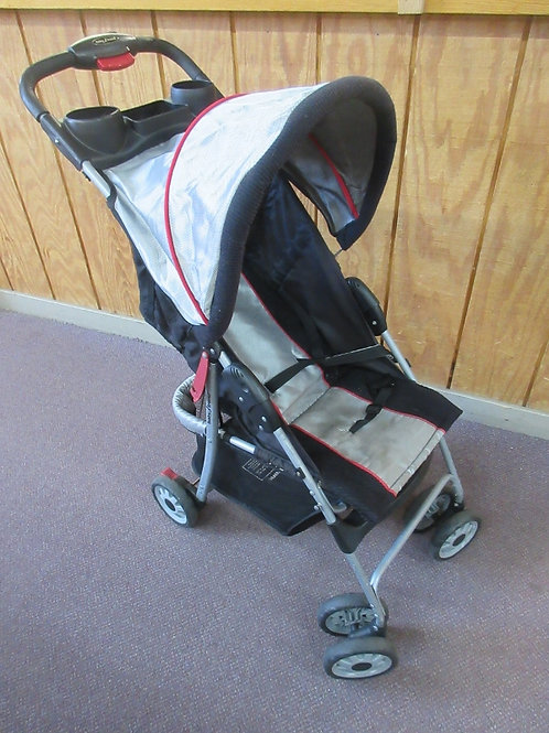 Baby trend black and silver fold up stroller w/cup holders