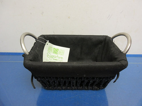 Black rectangular wicker basket with metal handles and cloth liner