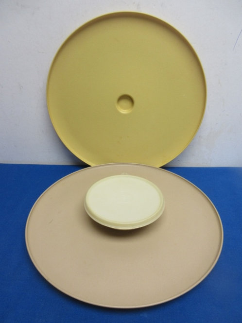Pair of tupperware serving  dishes, one has a dip container attached