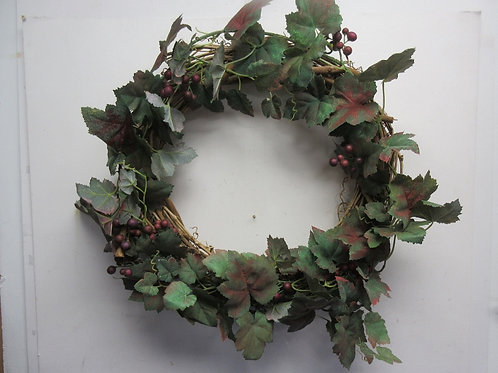 Vine wreath with grapes and grape leaves