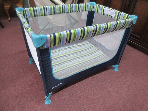 Blue and green striped pack and play