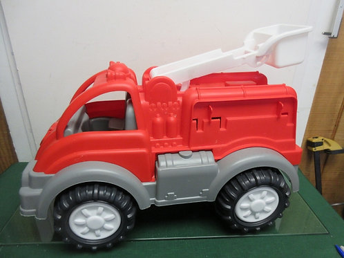 Large red platic fire truck with moveable ladder