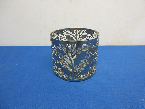 Metal cut out votive candle holder with glass votive candle