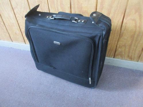Overland travel gear, large black suitcase