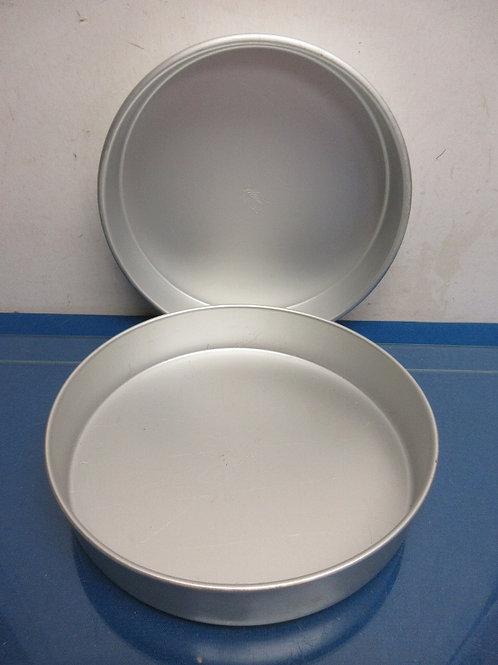 "Pair of Wilton aluminum cake pans, each 10x2"""