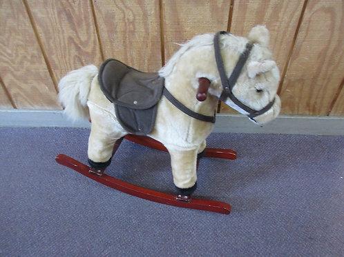 "Soft small plush rocking horse, makes gallopping sounds, 24""longx 20""high"