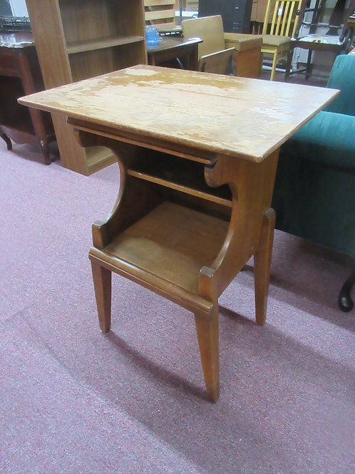 Small vintage accent table with bottom storage, top is worn