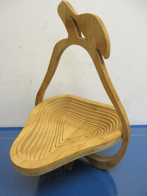 Pear shaped wooden expanding bowl cut out of one piece of wood