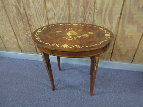 Antique oval accent table with gold floral inlay design and storage