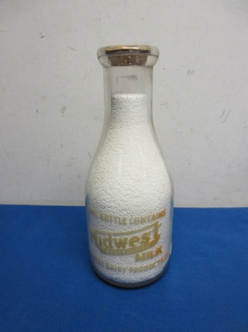 Decorative bottle of midwest milk filled with white beads