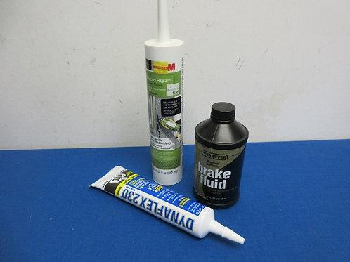 Bag of 2 caulking tubes, and bottle of brake fluid