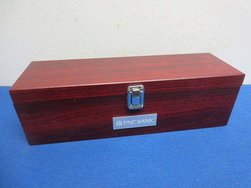 Woodbox for bottle of wine with opener and stopper