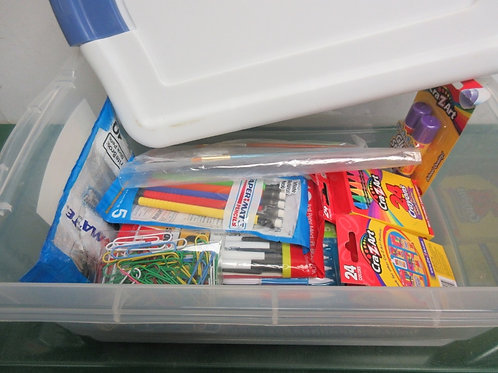 Sterlite clear container filled with school supplies-  pens, tablets, crayons, p