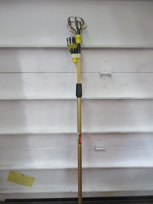 Light bulb changer with telescopic pole to assist in changing out of reach light