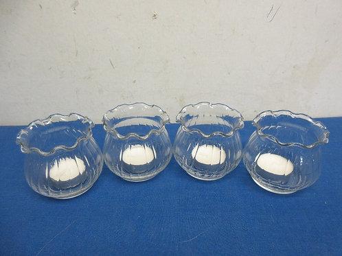 Set of 4 glass tea light candle holdes with 4 tea lights