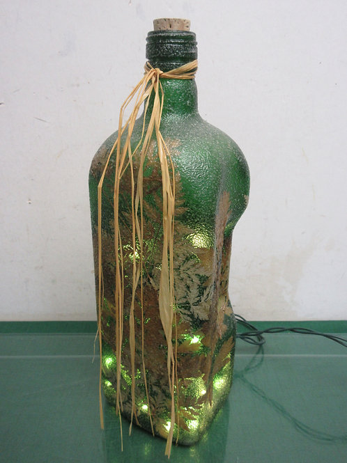 "Green decorative bottle with lights inside, 13"" tall"