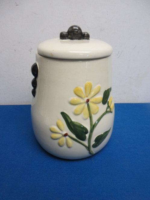 Ceramic cookie jar with yellow flower design