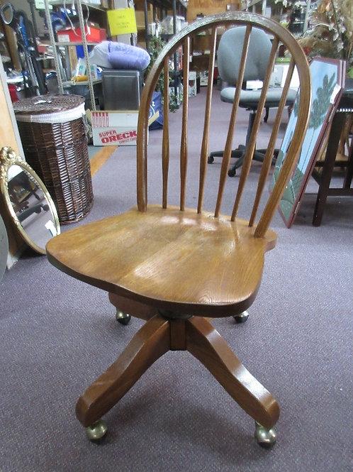 Vintage heavy oak desk chair with wood base, on wheels