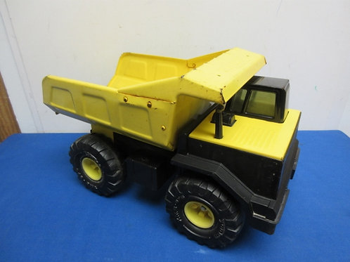 "Tonka metal and plastic dump truck, 17"" long"