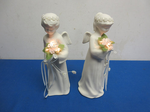 Pair of porcelain angel statues each holds a bouquet that lights up